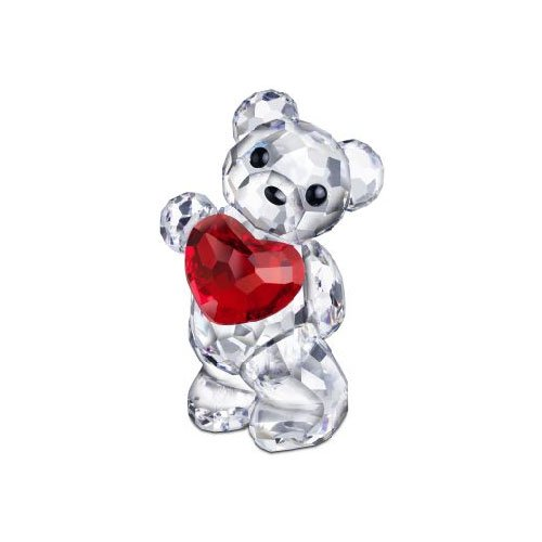 crystal bear holding a heart figurine
