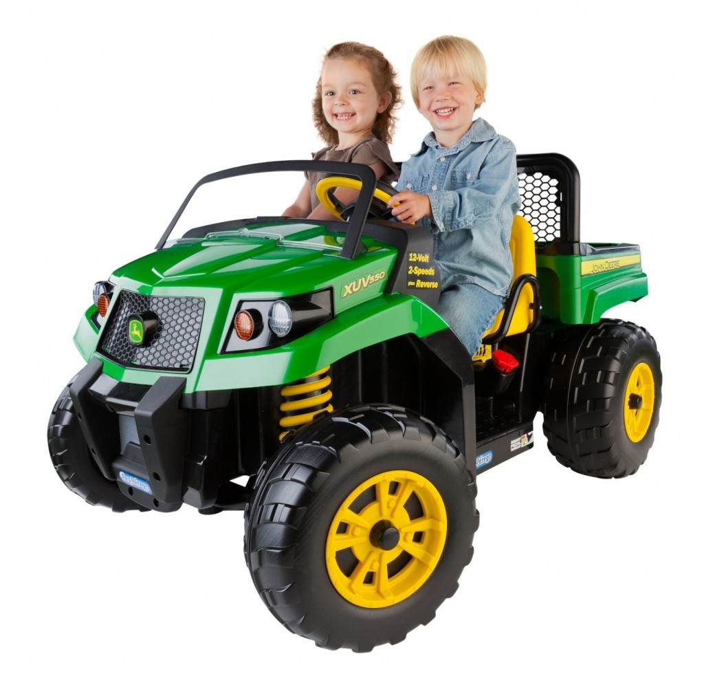 kids riding tractor green