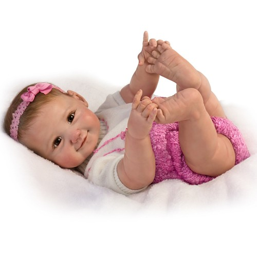 adorable poseable lifelike baby girl doll